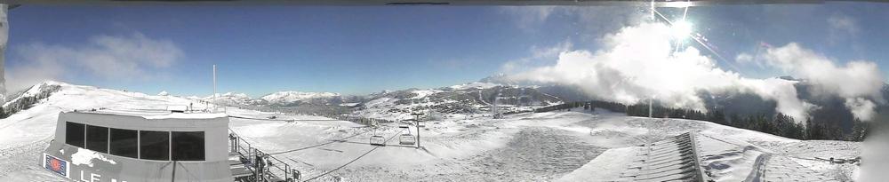 Neige fraîche et soleil depuis le sommet du Manant